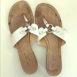 Kate Spade white and silver buckle sandal.